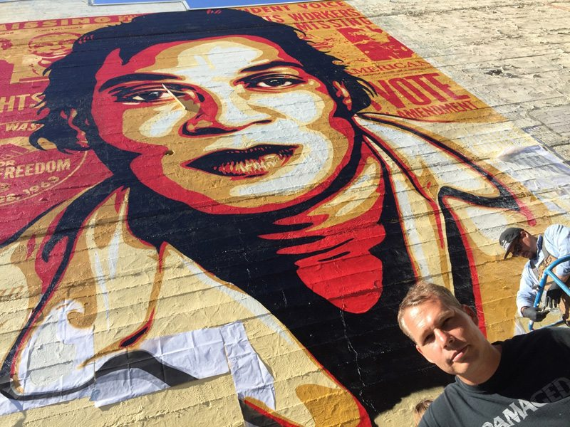 Shepard Fairey in front of his newest mural. (Peter Lawrence Kane)